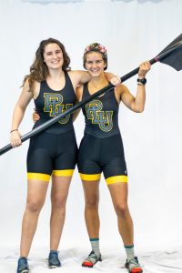 Ali in rowing gear with teammate
